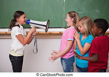 Schoolgirl screaming through a megaphone to her classmates