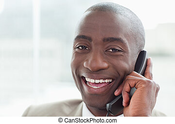 Close up of a cheerful businessman on the phone