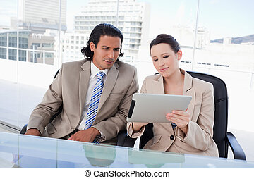 Business team using a tablet computer