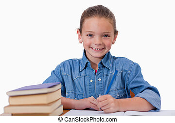 Smiling girl writing on a notebook