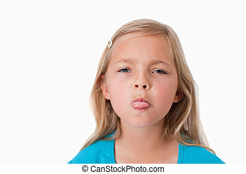 Girl sticking out her tongue against a white background