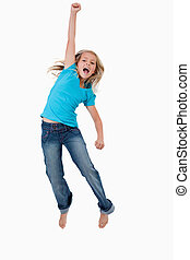 Portrait of a cheerful girl jumping against a white...