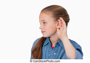Cute girl pricking up her ear against a white background