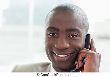 Close up of a smiling businessman on the phone
