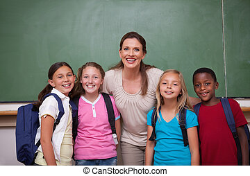 Schoolteacher posing with her pupils