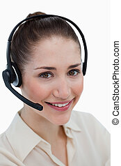 Portrait of a happy operator posing with a headset against a...