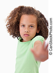 Portrait of a girl saying stop with her hand