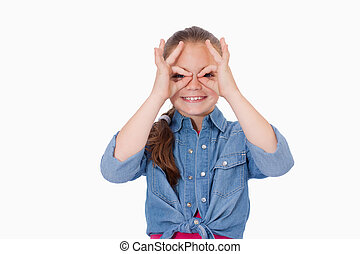 Girl with her fingers around her eyes