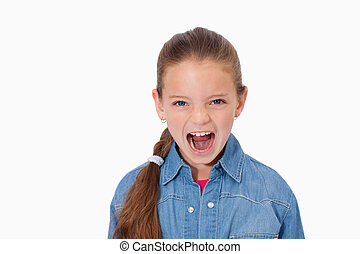 Unhappy girl screaming against a white background
