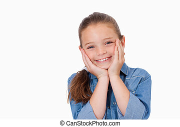 Girl posing with her hands under her chin