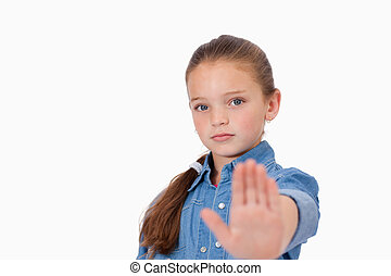 Girl saying stop with her hand