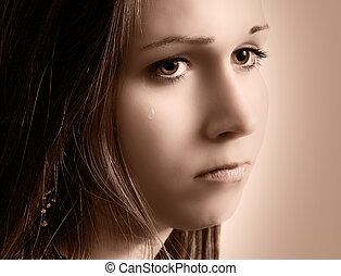 Sad girl with tears - Close up of tear rolling down cheek