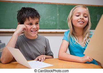 Smiling children reading
