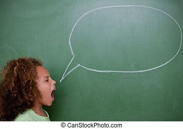 Schoolgirl screaming a speech bubble in front of a...
