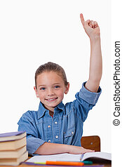 Portrait of a girl raising her arms