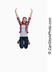 Portrait of a woman jumping against a white background