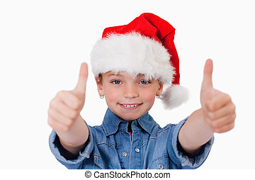 Girl with a Christmas hat and the thumbs up