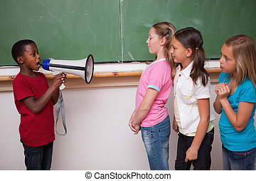 Schoolboy yelling through a megaphone to his classmates