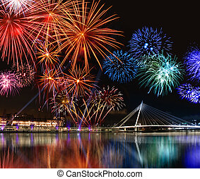 Colorful fireworks near water - Colorful fireworks reflect...