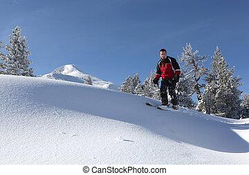 Male skier on a ski slope