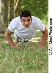 Man doing push-ups in the park