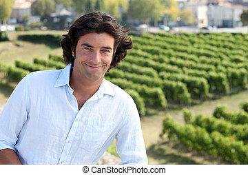 Man stood by vineyard