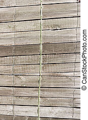 Close up of gray wooden fence panels