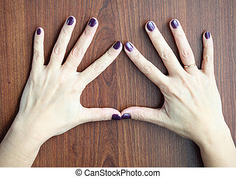 Woman Hands - Middle aged woman hands with shellac manicure...