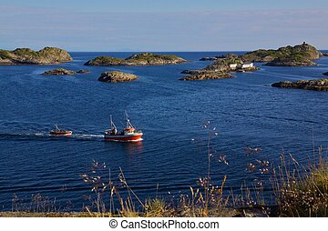 View on Lofoten - Fishing boats returning to port in...