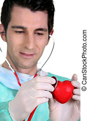 Doctor listening to the heartbeat of a heart