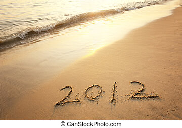Numbers 2012 on tropical beach sand