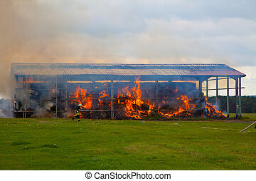 Burning warehouse, caused by arson