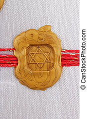 seal  - A golden seal as Star of David on silver background
