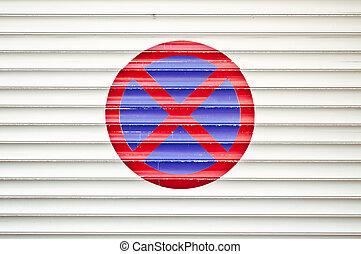 No Parking sign on garage door