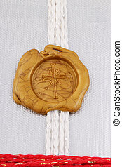 seal - A golden seal as cross with a band on silver...