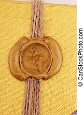 seal  - A golden seal as cross with a band