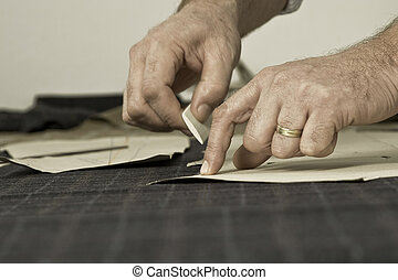detail of tailor's hand with chalk - Tailor at work, drawing...