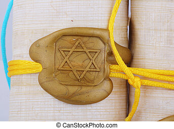 seal - A golden seal as Star of David on a papyrus role