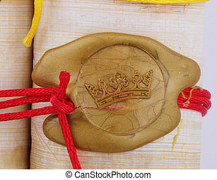seal - A golden seal as crown on a papyrus role