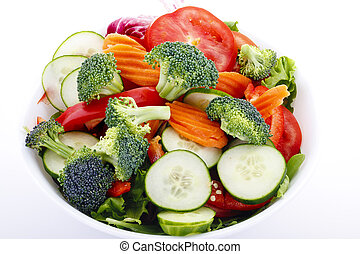 Cut Brocolli Cucumbers Carrots and Tomatoes - A bowl of...