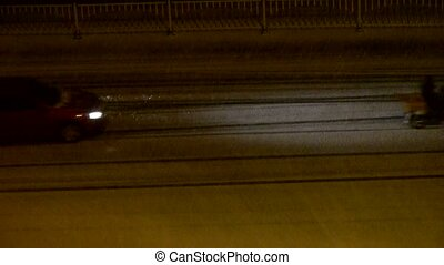 Vehicle car traveling on road in snow at night,traffic.