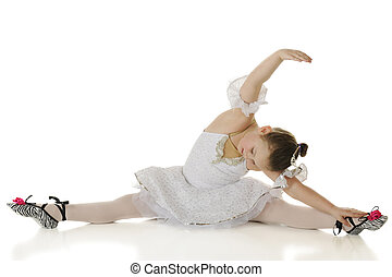 Graceful Stretch - A young elementary ballerina gracefully...