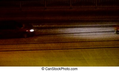 Vehicle car traveling on road in snow at night,traffic
