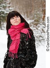 portrait of a beautiful young girl with a red scarf on the...