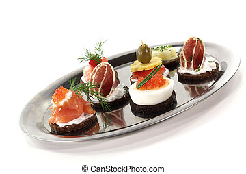 Hors d oeuvre - Pumpernickel bread with salmon, caviar,...