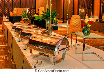 Food Warmer - Food warmers set up and ready for banquet in a...