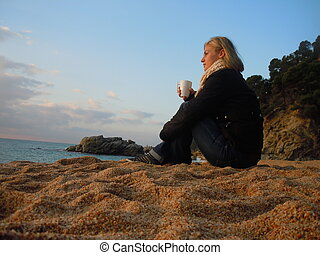 contemplating at the beach - young woman contemplating at...