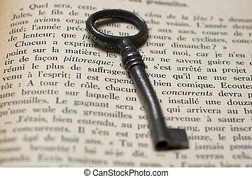 Old Key on a open book - An old Key on a open book