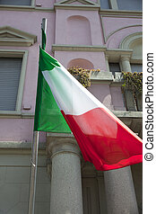 Italian flag on a pole in the building