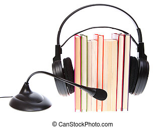 Books stack and headset with a microphone isolated